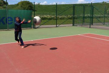 Alicia doing medicine ball throws
