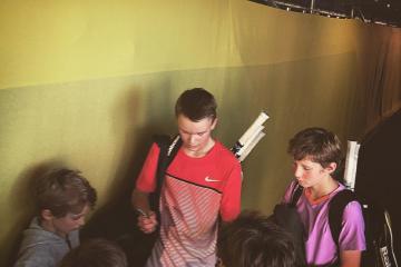 Giving autographs